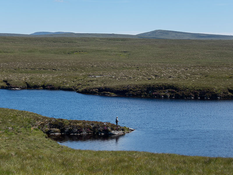 Dollag's Cottage guest fishing a remote Lewis trout loch